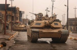 Materialism in the streets, U.S. Army M1 tanks in Tall Afar, Iraq,  3rd Armored Cavalry Regiment. DoD photo by Staff Sgt. Aaron Allmon, U.S. Air Force. (Released)